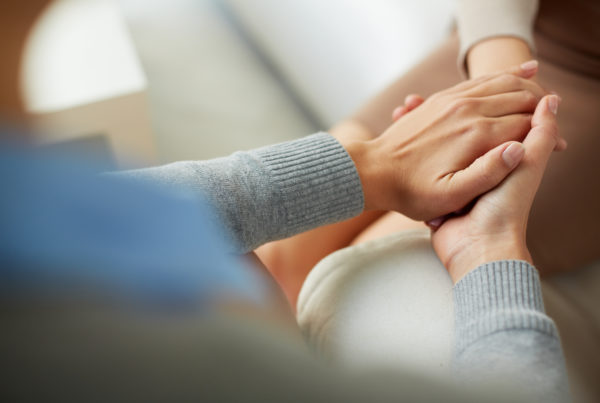 Counselor holding palm of her patient